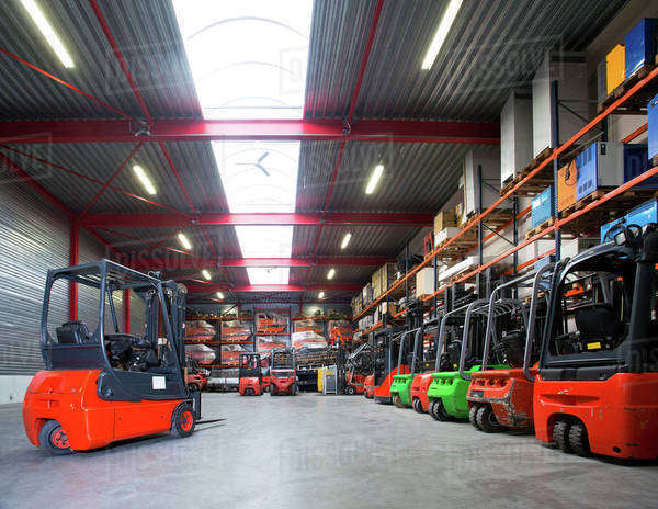 Forklift machinery in a row in warehouse Royalty-free stock photo