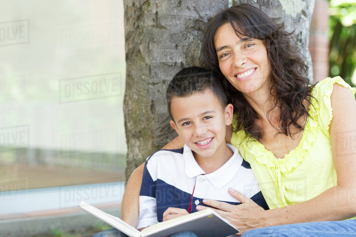 Hispanic mother and son reading book Royalty-free stock photo