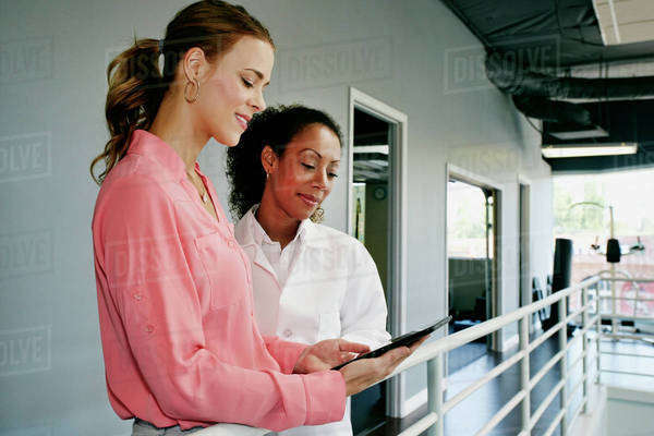 Businesswoman and doctor using digital tablet at railing Royalty-free stock photo