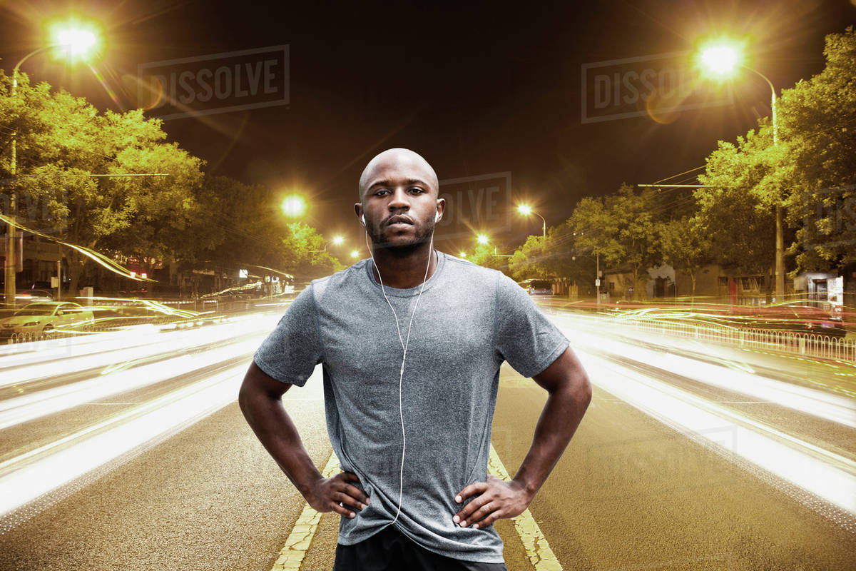 Time lapse view of Black runner standing on city street at night Royalty-free stock photo