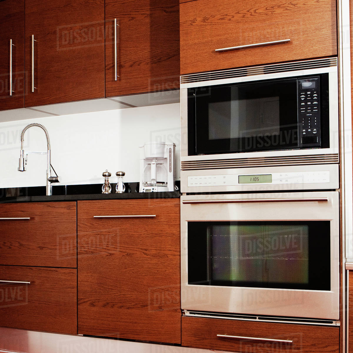 Oven Microwave Cabinets And Sink In Modern Kitchen Stock Photo