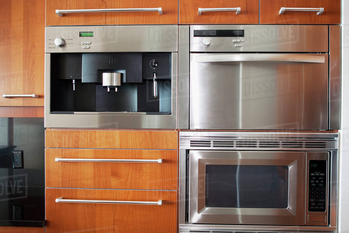 Ovens Microwave And Cabinets In Modern Kitchen Stock Photo
