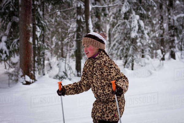 Caucasian girl cross-country skiing in forest Royalty-free stock photo