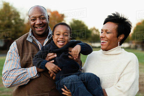 African American family playing in park Royalty-free stock photo