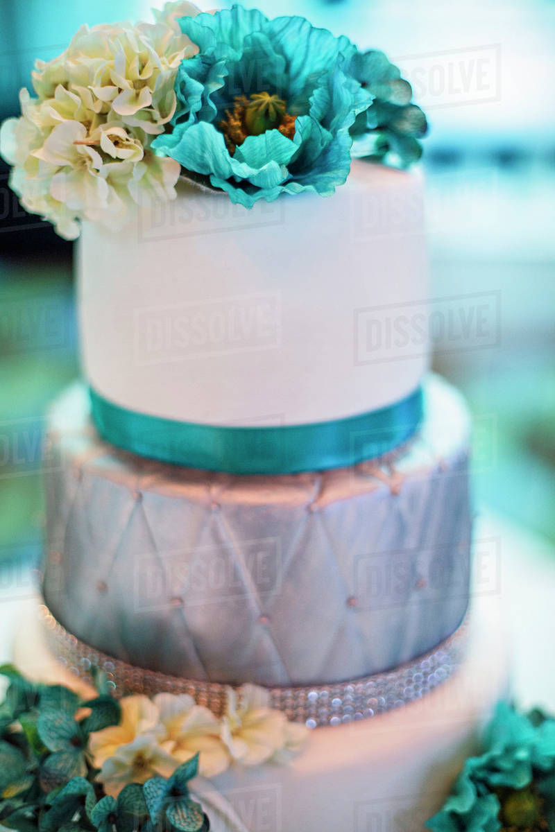Blue And Silver Wedding Cake With Flowers Stock Photo Dissolve