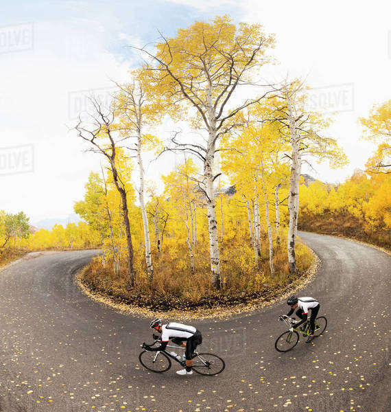 Caucasian cyclists on rural road Royalty-free stock photo