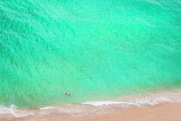 Aerial view of Caucasian man swimming in ocean on beach Royalty-free stock photo