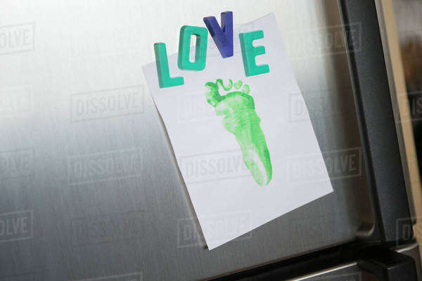 Close up of love magnets and footprint on refrigerator Royalty-free stock photo