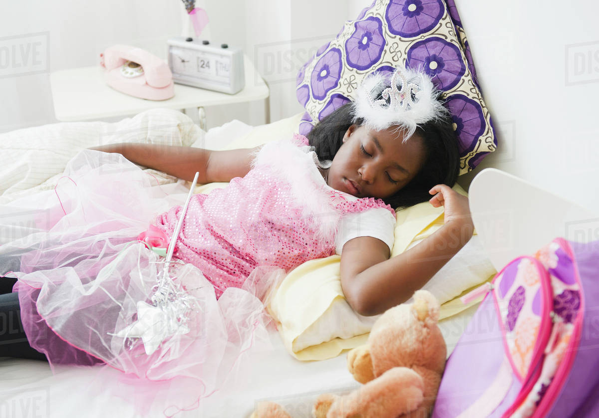 Black girl sleeping in fairy costume Royalty-free stock photo
