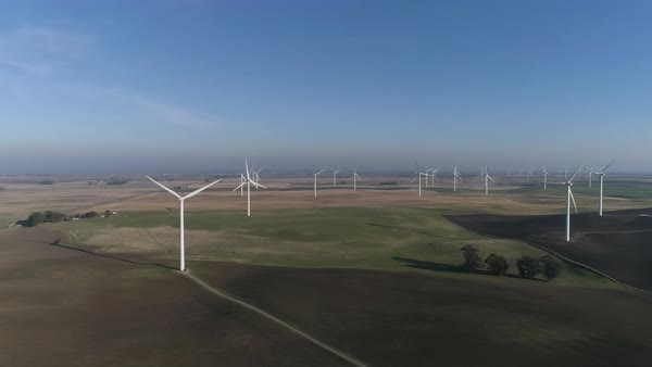 Aerial shot of wind turbines in a lush green field on Montezuma Hills Royalty-free stock video
