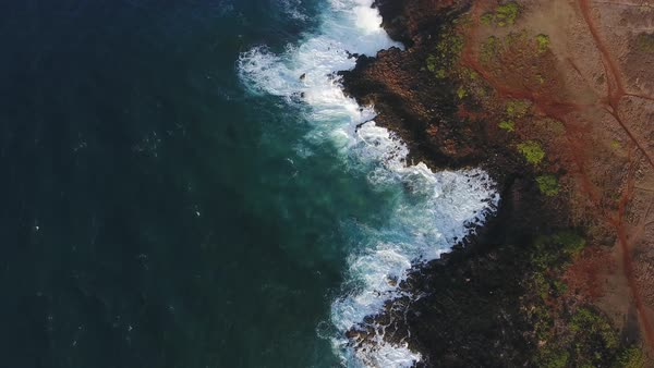 Aerial shot of waves breaking on a rocky shore Royalty-free stock video