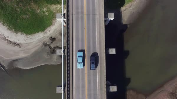 Drone shot of two cars crossing a bridge Royalty-free stock video