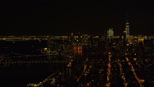 Aerial shot of skyscrapers in Lower Manhattan with East River visible, at night Rights-managed stock video
