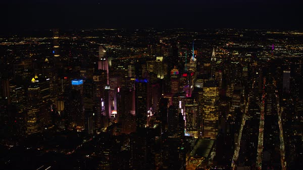 Aerial shot of skyscrapers around Times Square at night Rights-managed stock video