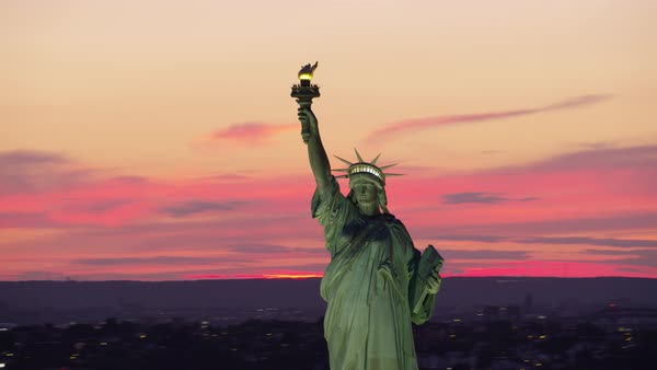 Aerial shot of Statue of Liberty at twilight Rights-managed stock video