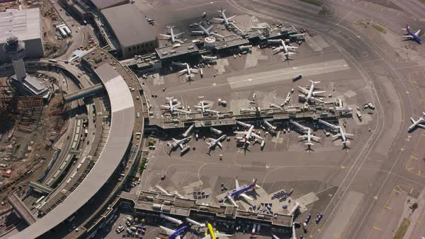 Aerial shot of airplanes parking at an airport in New York City Rights-managed stock video