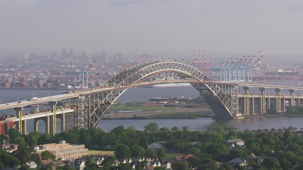 Aerial shot of Bayonne Bridge with a harbor in background Rights-managed stock video