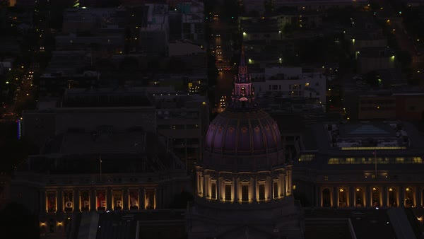 Aerial shot of dome of illuminated San Francisco City Hall Rights-managed stock video