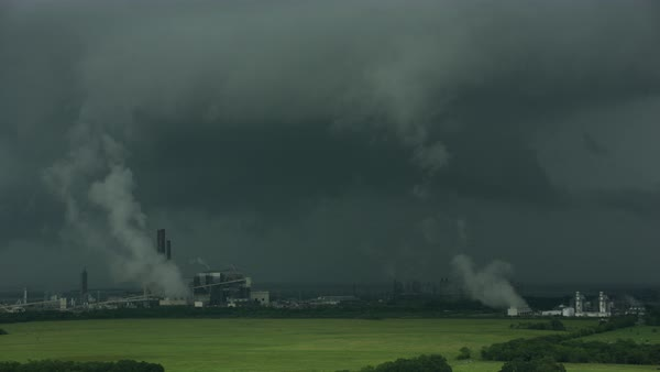 Aerial shot of storm clouds over an industrial complex in Louisiana Rights-managed stock video