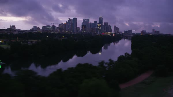 Aerial view of Austin cityscape on the banks of Colorado River Rights-managed stock video