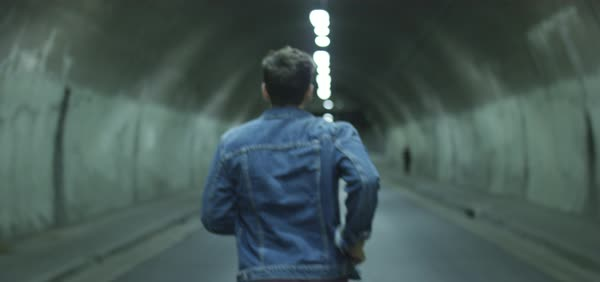 Slow motion shot of a man running in a tunnel Royalty-free stock video