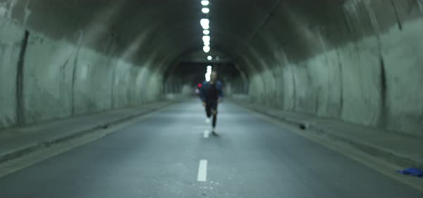 Slow motion shot of a man running towards camera in a tunnel Royalty-free stock video