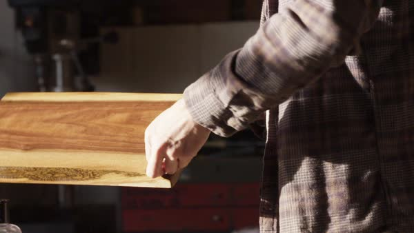 Slow motion shot of two men applying oil finish on wood Royalty-free stock video