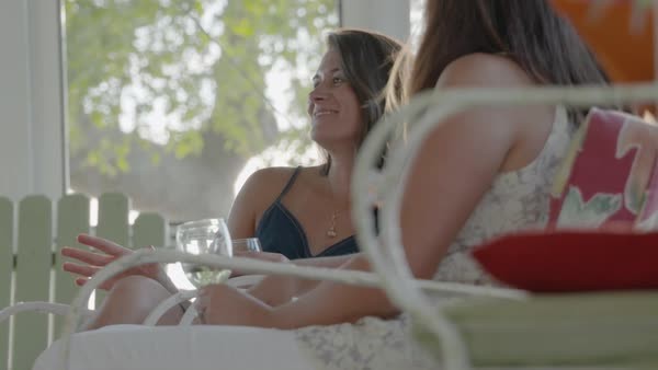 Slow motion shot of women talking and holding drinks Royalty-free stock video