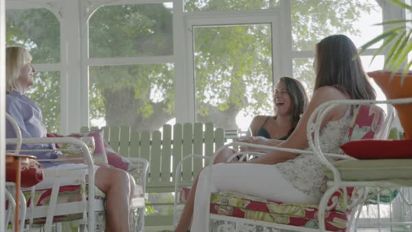 Zooming out shot of three women talking and holding drinks Royalty-free stock video