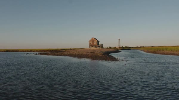 Drone shot of a stilt house on shore of Hog Island Bay Royalty-free stock video
