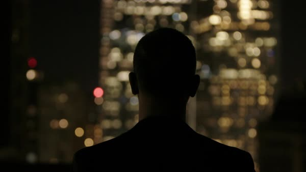Hand-held shot of a man viewing illuminated skyscrapers in New York City Royalty-free stock video