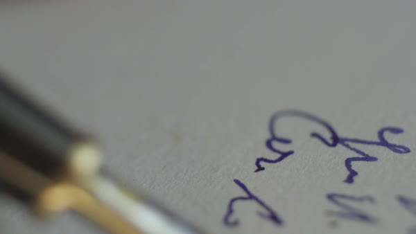 Close-up of a hand writing with a fountain pen on paper Royalty-free stock video