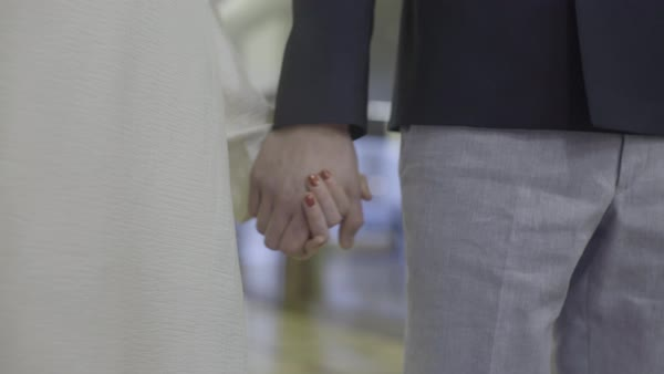 Hand-held shot of a couple holding hands Royalty-free stock video