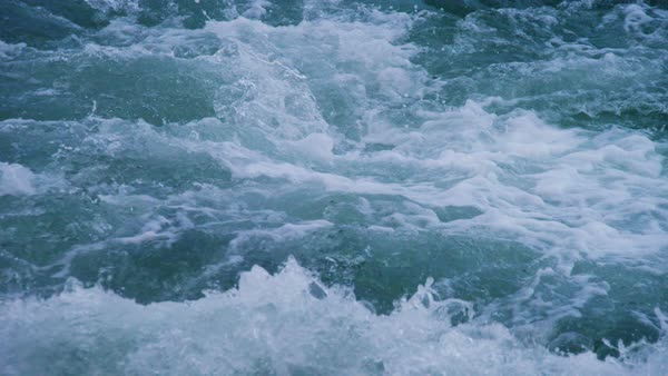 A full shot of waves of the water. Shot pans to the right. Royalty-free stock video