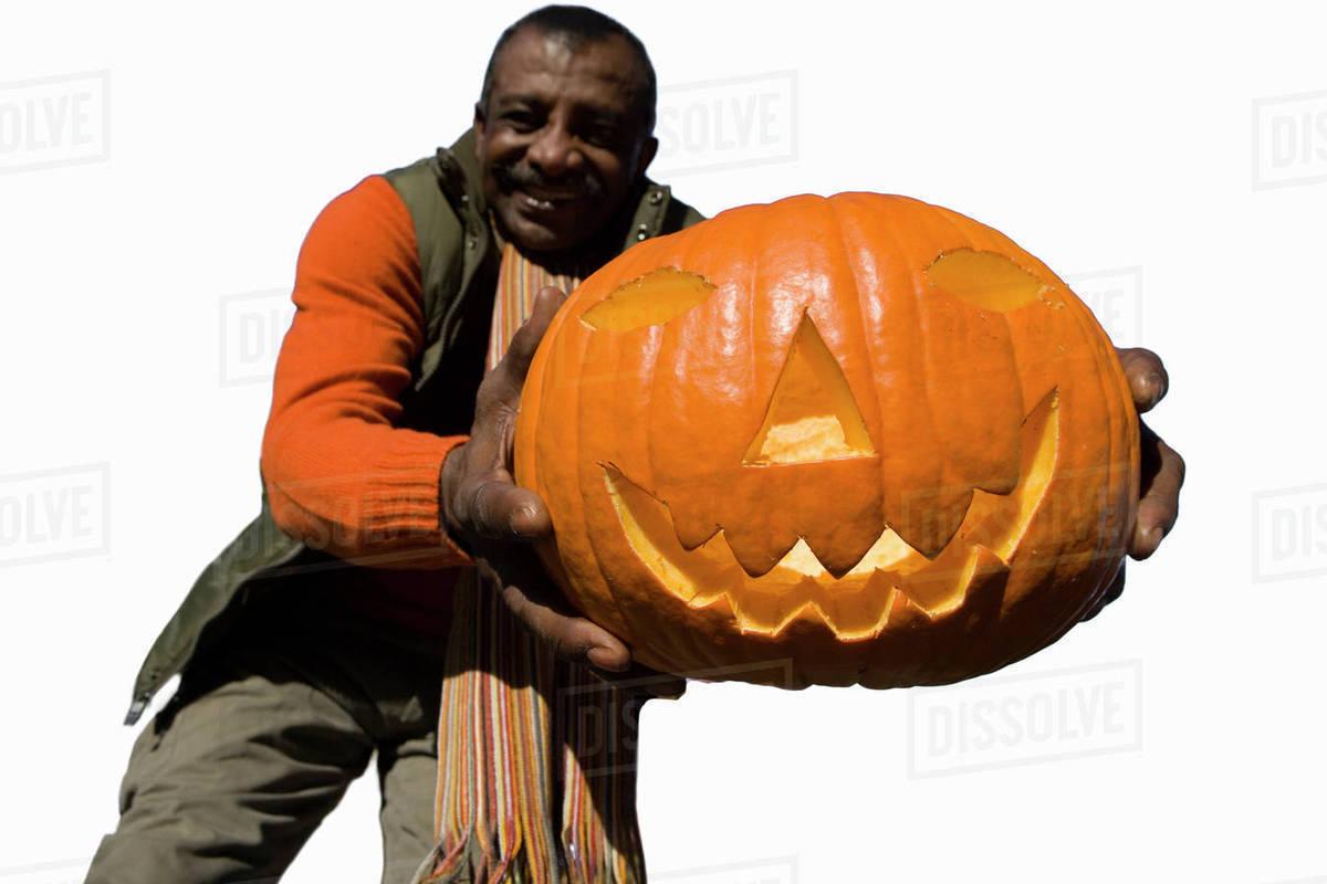 senior man holding large pumpkin cut out stock photo dissolve
