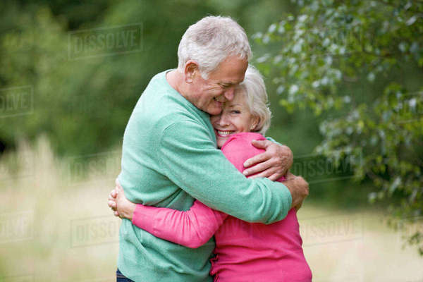 Portrait of a senior couple hugging, outdoors Royalty-free stock photo