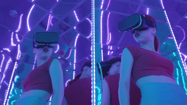 A young woman wearing VR goggles in a mirrored room  Royalty-free stock video
