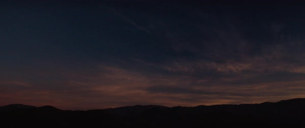 Static shot of dramatic sky at sunset, silhouetted mountain in foreground, Los Angeles, California, United States of America Royalty-free stock video