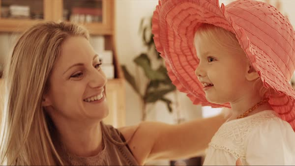 Mother and daughter playing with pink hat Royalty-free stock video