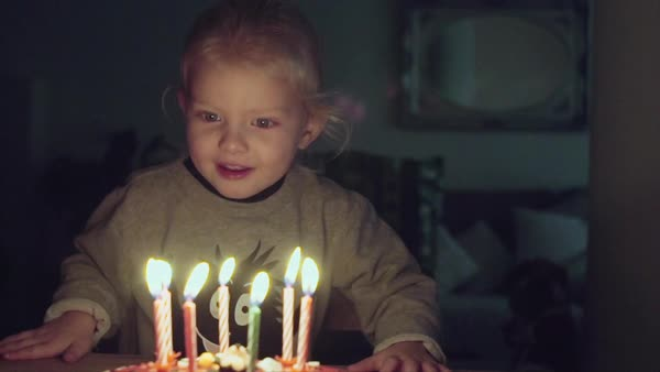 Young girl blowing out birthday candles Royalty-free stock video