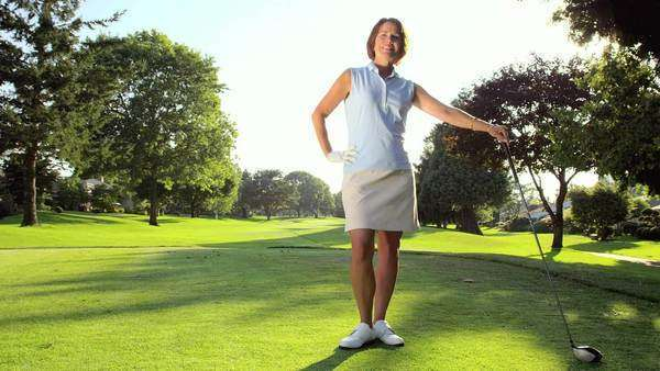 Female golfer looks into the camera. Wide shot. Royalty-free stock video