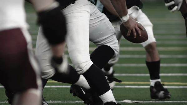 Low angle foot shot of football players running a play Royalty-free stock video