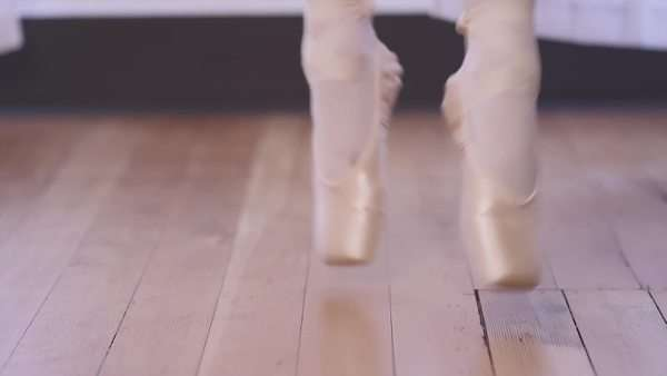 Close-up of a ballet dancer's shoes as she does small jumps Royalty-free stock video