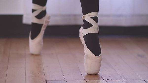 A ballet dancer's shoe goes in and out of focus as she changes positions Royalty-free stock video