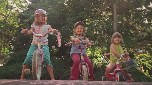Three sisters sitting on their bikes and smiling Royalty-free stock video