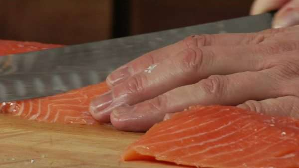 A chef slices fresh Salmon fillet Royalty-free stock video