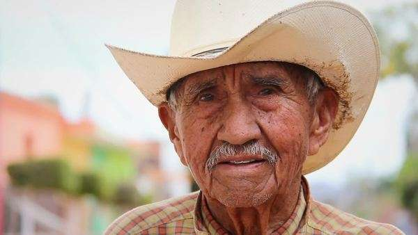 A old Mexican cowboy poses for the camera in a small town in Mexico Royalty-free stock video