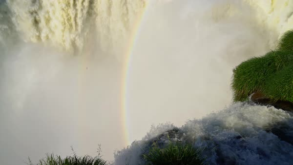 Pan up to top of Devil's Throat Falls and rainbow Royalty-free stock video