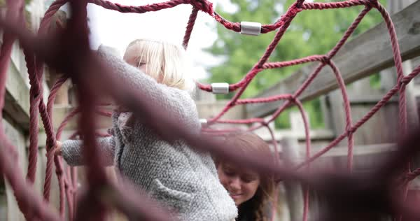Mother and daughter in playground playing Royalty-free stock video
