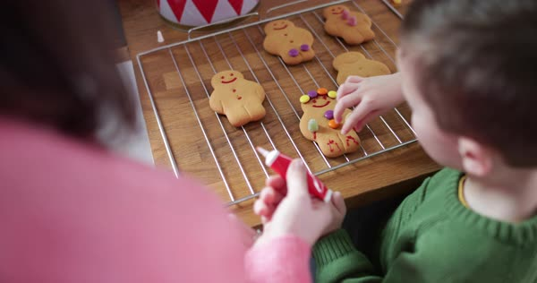 Mother and son decorating gingerbread men Royalty-free stock video